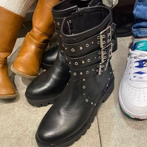 Black studded boot. Very trendy. New with Tags.